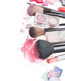 Brushes on eye shadows palette Royalty Free Stock Photos
