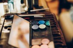 Brushes and eyeshadows palette. makeup set of brushes, powder, e royalty free stock photography
