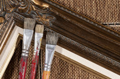 Brushes and frame. Paint brushes and wood picture frame stock image