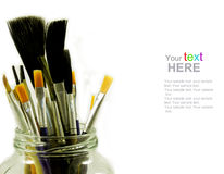 Brushes in glass jar Stock Photo