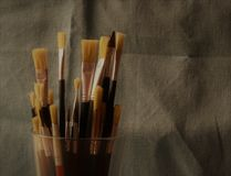 Brushes in a glass Stock Photos
