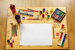 Brushes, gouache, watercolors, pastels, brushes and pencils laid Stock Images