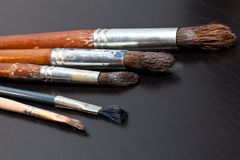 Brushes on gray background Stock Image