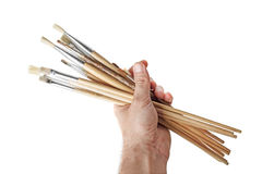 Brushes in hand of the artist Royalty Free Stock Image