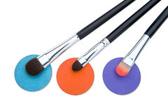 Brushes for make-up. Female color cosmetics and brush for a make-up on a white background Royalty Free Stock Photography