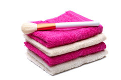 Brushes for make-up , on pink, white towel Royalty Free Stock Photography