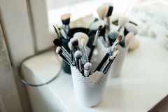 Brushes for make-up. Stand in the white cup Royalty Free Stock Photography