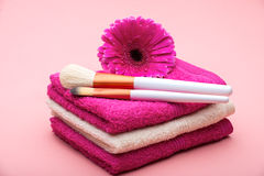 Brushes for make-up  on towel with  big pink flower Stock Photography