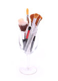 Brushes for makeup in glass on white Royalty Free Stock Photography