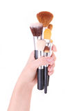 Brushes for makeup in hand isolated on white Royalty Free Stock Image
