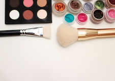 Brushes and makeup pigments. Royalty Free Stock Images