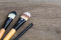 Brushes for makeup. On the wooden background Royalty Free Stock Photos