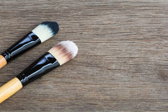 Brushes for makeup. On the wooden background royalty free stock image