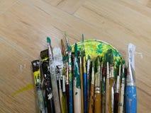 Brushes. Many colorful paint brushes on floor Royalty Free Stock Photo