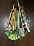 Brushes. Many colorful paint brushes on floor Royalty Free Stock Photography