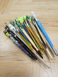 Brushes. Many colorful paint brushes on floor Stock Images