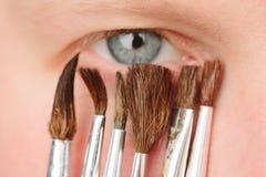 Brushes near  blue eye Royalty Free Stock Images