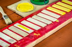 Brushes, paint and boards. Stock Photos