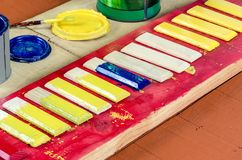 Brushes, paint and boards . Royalty Free Stock Photo