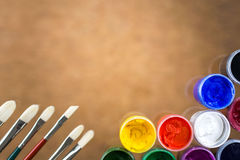 Brushes and paint on brown Stock Images