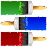 Brushes with Paint. Brush with red, blue and green paint on a white background isolated Royalty Free Stock Photo