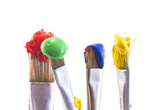 Brushes with Paint Isolated on White Stock Photo