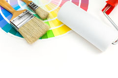 Brushes and paint roller over color Stock Images