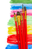 Brushes on paint spots Stock Photography