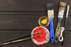 Brushes and paint on a wooden table. Painter tools. Workshop painter. Needs painting. Sales painting needs. Royalty Free Stock Photography