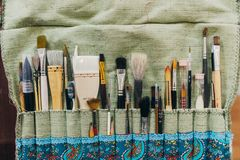 Brushes. Paintbrush collection top view. Artists workplace. stock image