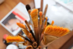 Brushes painter. Camera angle from above focuses bristle brush. The picture shows a fragment of the artist's workplace Royalty Free Stock Image