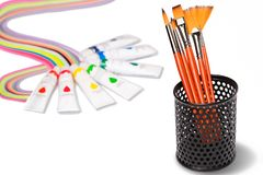 Brushes for painting in a black box. Colored paints in tubes Stock Photo