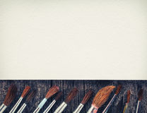 Brushes for painting  and blank white paper sheet Royalty Free Stock Photos