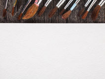 Brushes for painting  and blank white paper sheet Stock Photo