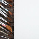 Brushes for painting  and blank white paper sheet Royalty Free Stock Image