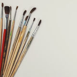 brushes for painting  and blank white paper sheet Royalty Free Stock Photography