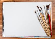 brushes for painting  and blank white paper sheet Stock Photography