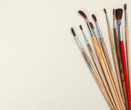 brushes for painting  and blank white paper sheet Royalty Free Stock Photo