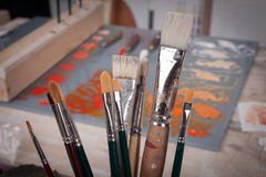 Brushes for paintings in a studio Stock Image