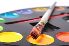 Brushes and paints Stock Photography