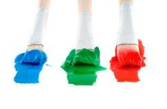Brushes with paints. Isolation on white royalty free stock image