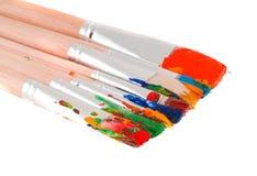Brushes with paints. Isolation on white stock image