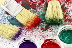Brushes with paints Stock Photos