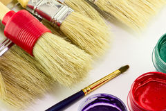 Brushes with paints. Close up of colorful paint and brushes Royalty Free Stock Images
