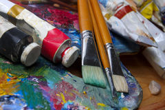 Brushes, paints and pallette Royalty Free Stock Photography