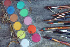 Brushes and paints on the table. Brushes and paints for coloring eggs for Easter royalty free stock images