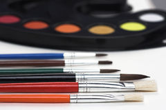 Brushes and palette Stock Photography