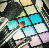 Brushes and palette with eyeshadow for applying makeup Royalty Free Stock Photography