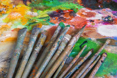 Brushes and palette with paints Stock Photos