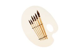Brushes and palette Stock Image